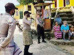 Kenakan Pakaian Adat, Polsek Senayang Imbau Terapkan Protokol Kesehatan Covid-19 5