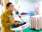 Kepala Dinas Pemberdayaan Masyarakat dan Desa Kabupaten Natuna, Anrizal Zen, menyampaikan laporan kegiatan